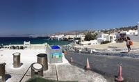 Mikonos harbour from windmills with the ship anchored outside the port, we