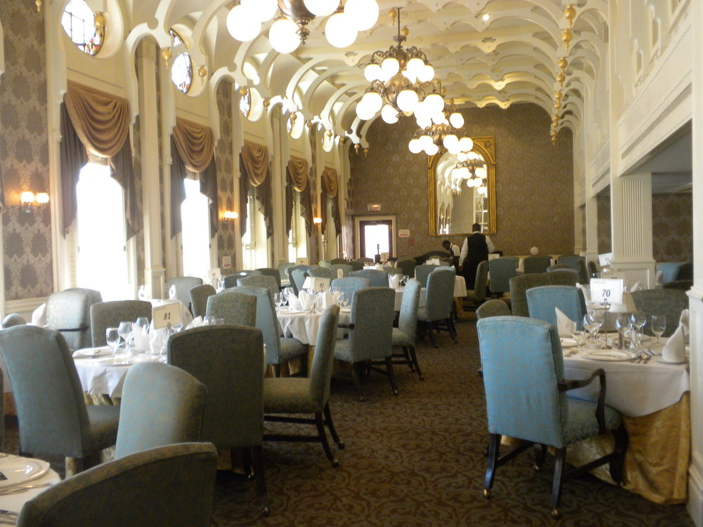 One side of the J. M. White Dining Room. Note oval, stained-glass windows a