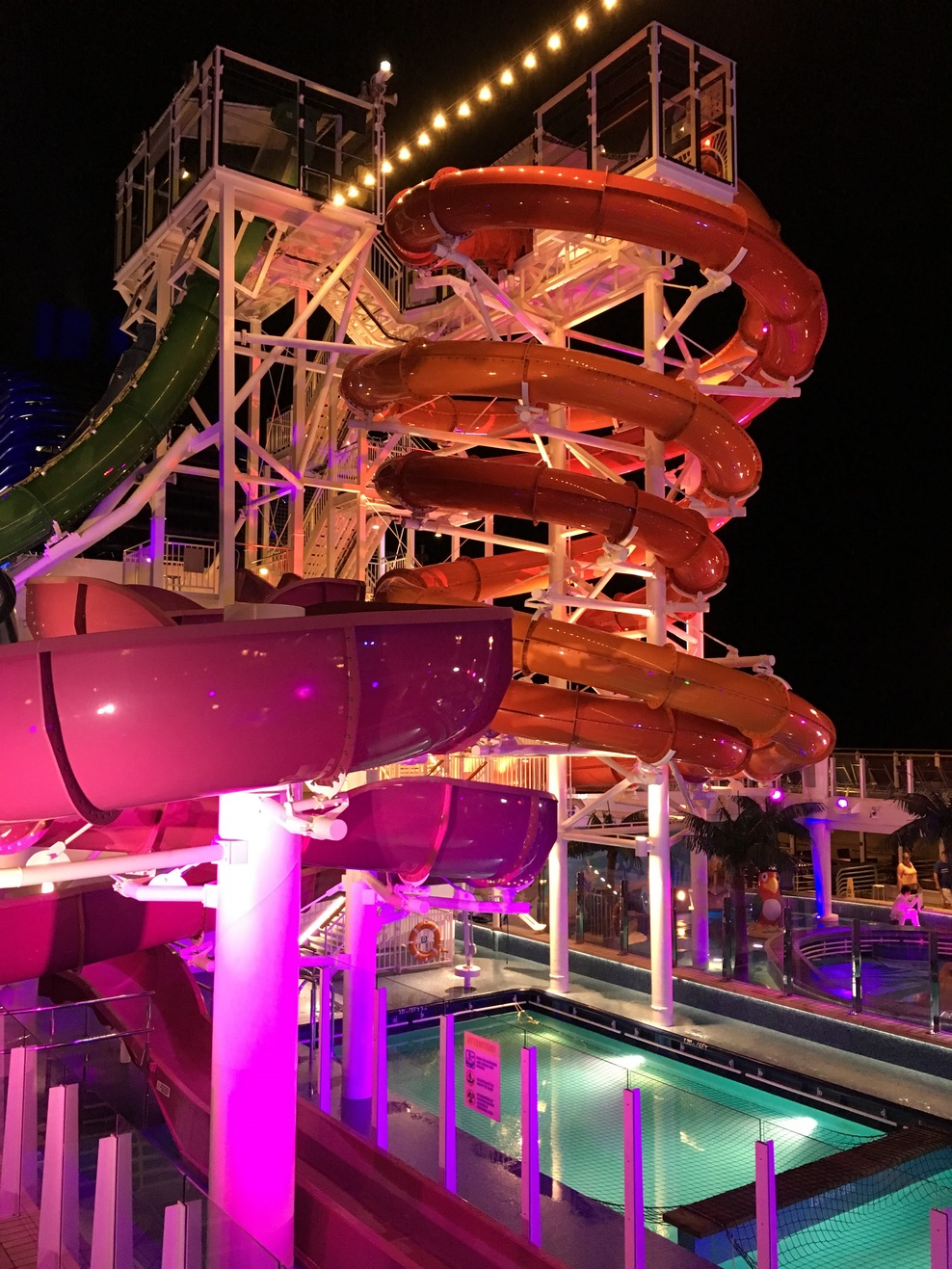 Water slides and pool at night.