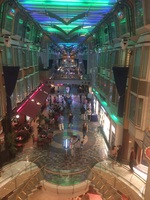 A picture, taken from the balcony, of the shopping boulevard on the ship.