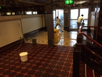 crew cleaning up after waves flooded deck 3 by taj mahal.
