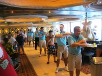 Lido staff and passengers dancing on the last morning as we arrived in New Orleans