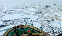 Breaking the ice of the Laptev sea , and the 2 helicos  on flight