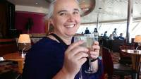 The missus with a glass of Champers at the olive or twist bar atop the ship