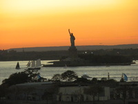 sunset New York City with statue of Liberty