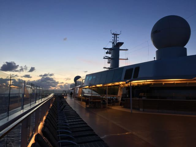 Sunrise at sea looking forward on Deck 15 on the walking track.