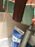Cracked, chipped stateroom bathroom mirror.