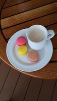 Macaroons and cappuccino on board.
