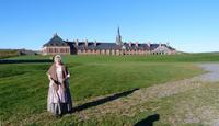 Arrival at fortified old city of Louisbourg, Nova Scotia, with people in pe