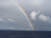 Sea day after rain. Beautiful rainbow.