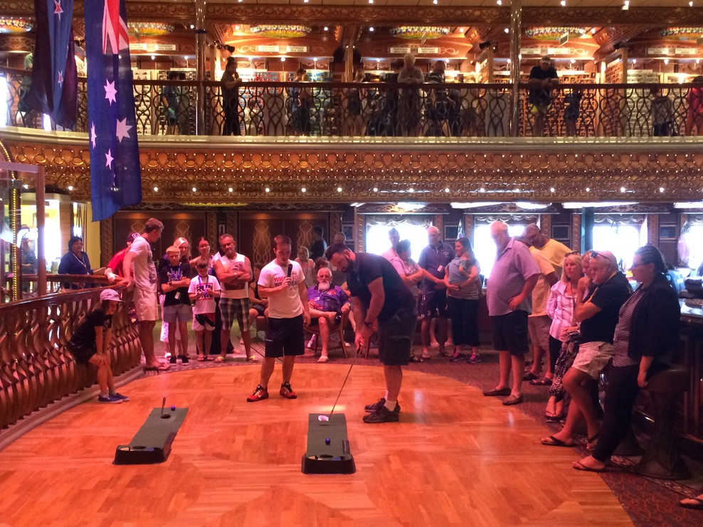 Atrium bar/lounge at the centre of the ship while a putting competition was