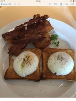 Breakfast, poached eggs on toast, and crispy bacon
