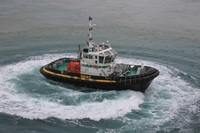 Tug boat doing 360's saying goodbye at Nomea