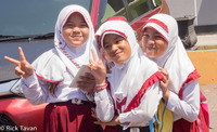 Three happy girls in Ternate, Indonesia