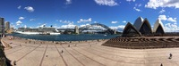 Panoramic shot that shows Sydney's iconic bridge, Opera House and the C