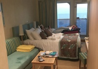Our Stateroom. The spot on the couch is just water from a swimsuit. Wish I