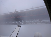 Sailing under the Golden Gate bridge in heavy fog. Very cool!