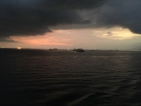 Ships waiting to pass east through the Panama Canal as night was falling.
