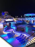 The outdoor pool deck at night, beautiful