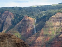 Waimea Canyon lookout with the waterfall in the background. Know as the Grand Canyon of the Pacific. On the island of Kauai