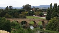 Photo of the oldest bridge still in use in Australia. It was built by convicts in 1825 and is located in the small village of Richmond in Tasmania.