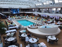 Lido deck. Movie screen in distance. Hot tubs in foreground. Deck above has