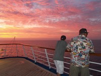 Grandpa and Grandson share a Pacific Coast sunset aboard Carnival
