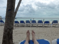 Sitting on the beach on Coco Cay