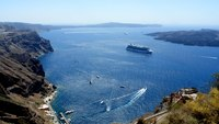 Celebrity Equinox is waiting for passengers in Santorini bay. Amazing view from Fira!