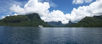Panoramic photo of Paul Gauguin anchored in Opunohu Bay, Moorea. Taken from