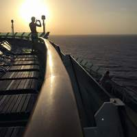 A friend taking a photo on the ship at sunset