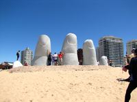 The Dedos (fingers) rising out of the sand on a beach in Punta del Este