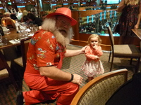Santa and little Rose.  She adored him and ran to him every time we were ne