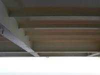 Big metal roof enclosing balcony, stopping any sun at all. Celebrity Const