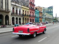 Old Havana - mid day activity and traffic in front of the Capitol.  Historical charm!