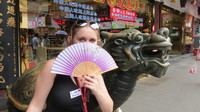Emma with her new fan in the Shanghai Market.