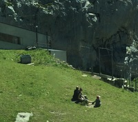 People relaxing on the mountainK