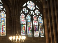 One of several beautiful, stained- glass widow panes inside the Cologne Cat