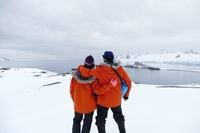 First stop in Antarctica. Ship in the distance. Parkas you are given to kee