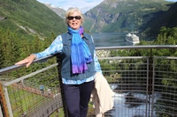 At the top of beautiful water falls in town of Geiranger Norway with fjord