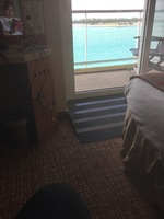 Ramp leading to balcony in wheelchair accessible cabin 7141 on Celebrity Su