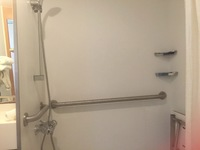 Roll-in shower of cabin 7141 on Celebrity Summit. The fixed seat is on the