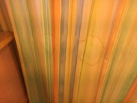 Picture of stained curtain AFTER they supposedly cleaned it