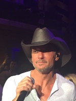 Tim McGraw singing in the aisle right next to me.