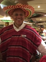 Godfrey our waiter in the Empire. Mexican night