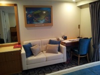 The dressing table, sofa and desk in the Balcony Stateroom.