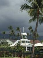 A church under the cloudy skies in Kona.
