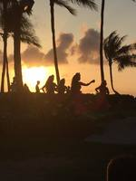 A picture of the Imu ceremony at the Paradise Cove Luau at sunset.