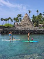 Paddle boarding in front of Aheuna Heiau