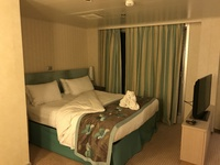 Bed area, which has sliding door to the long balcony area.  Photo taken fro